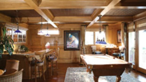 Willard Woodworks produced this game room, featuring distressed alder with raised panel wainscoted walls and coffered ceilings with stamped copper ceiling tiles.