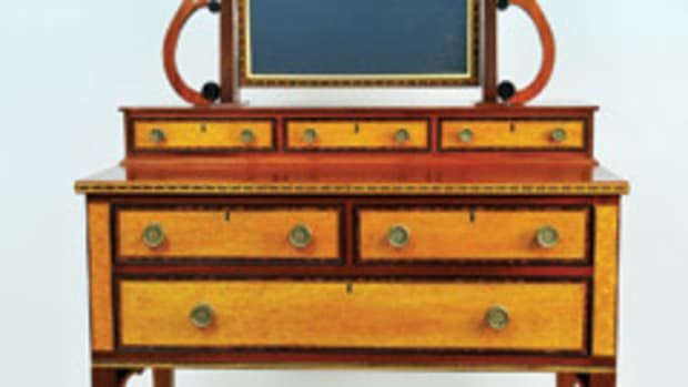 The Society of American Period Furniture Makers exhibit features this Federal dressing table by James Hardwick.