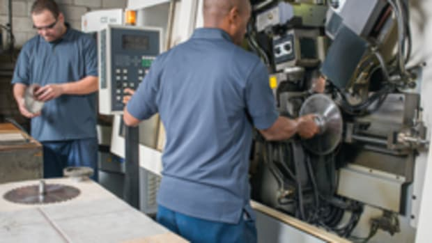 After inspection, saw blades are loaded in a Vollmer CNC-controlled sharpener.