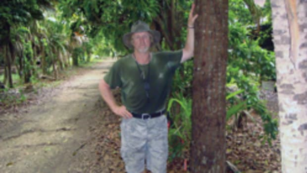 Michael Tisdale in his backyard jungle.