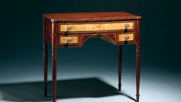 """The New Hampshire Furniture Masters Association's exhibit featured this hall table by Bill Truslow, an ash desk by Ted Blachly, Richard Oedel's """"Wild Rose"""" console table and """"Two Energies"""" by Brian Sargent."""