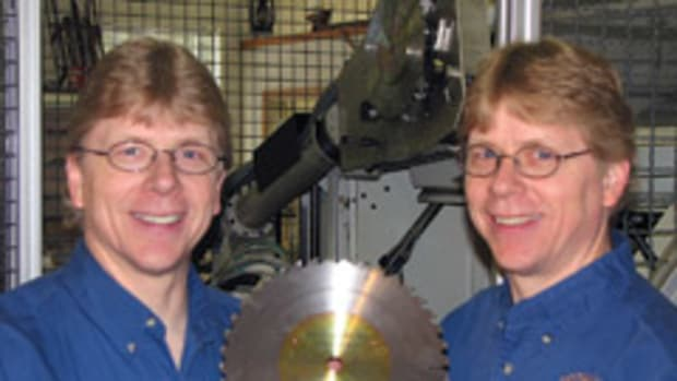 "Don (left) and Ron Angelo, co-owners of Total Saw Solutions, with the company's new Micro-Kerf 40, a 10"" table saw blade."