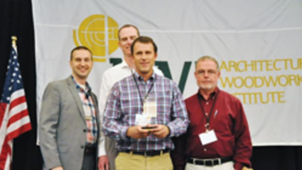 Stephenson Millwork leaders accept the overall Standard of Excellence Award at the AWI conference.