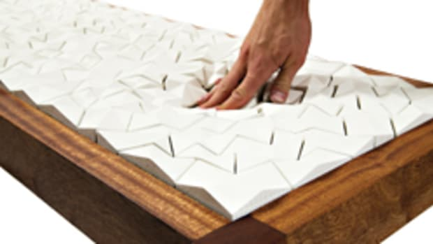 "Annie Evelyn's ""Floe,"" in collaboration with Ian Henderson, made with sapele, foam and cement. Cast cement tiles were ""upholstered"" to the sapele frame using a traditional button tufting technique."