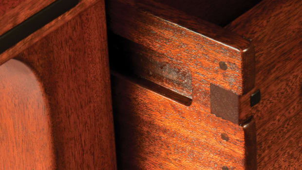 Exposed and highlighted joinery on a drawer shows off the mahogany with ebony accents and showcases the artist's talent.