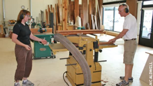 Alison Swan-Ingram, left, and Carl Johnson work together at Franklin Street Fine Woodwork in Tampa, Fla.