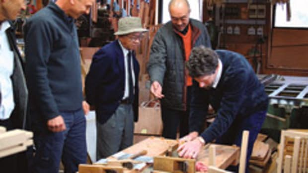 Jeffrey Cooper tries out a Japanese-style plane, which cuts on the pull stroke, at the shop of Toyama-san, a maker of American-style furniture.