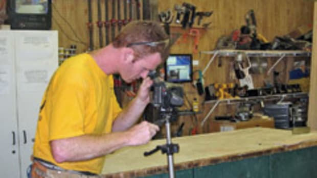 Chris Davis sets up one of four Web cameras that stream live online video from the shop and showroom at Waterful Wonderbeds Furniture Gallery.