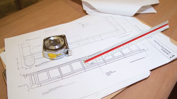 Photo of blueprint and measuring tape