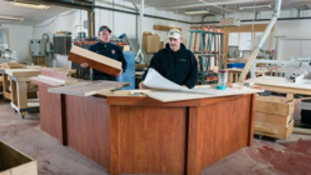Rich Davis (white hat) and Jeremy Woods at Hawk Hill Cabinetry's shop in Brandon, Vt., which produces kitchens, bathrooms and a whole lot more.