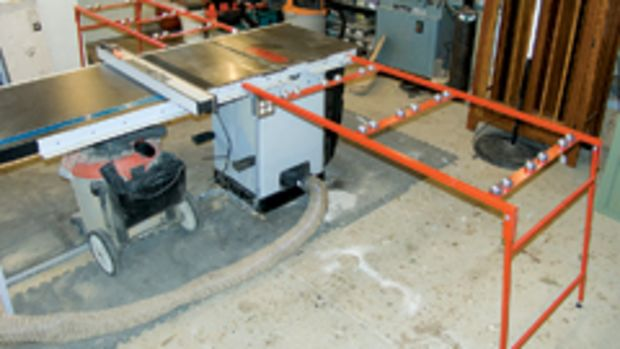 Ezee-Feed infeed and outfeed tables hook onto a table saw to support the cutting of sheet goods.