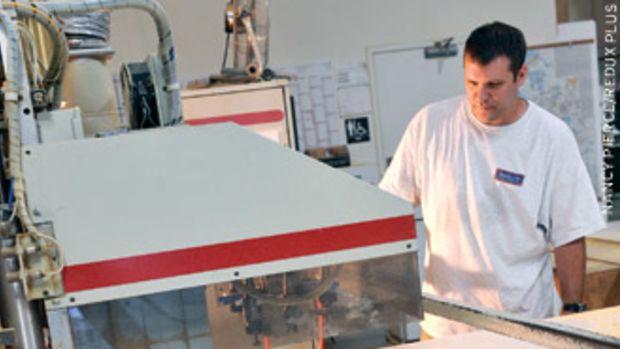 Matt Bash runs the shop's Komo CNC router.