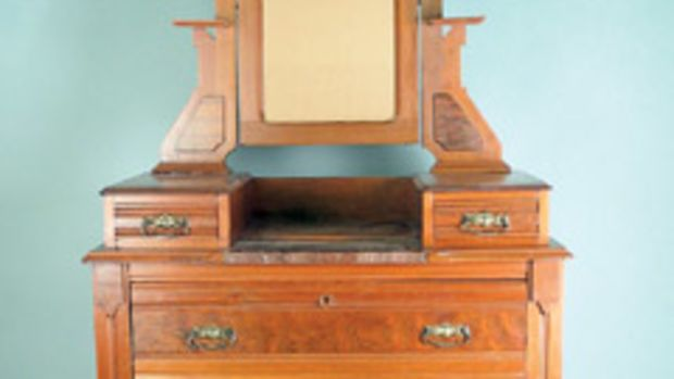 This Eastlake Victorian chest of drawers from the 1880s would be damaged if the finish was abraded.