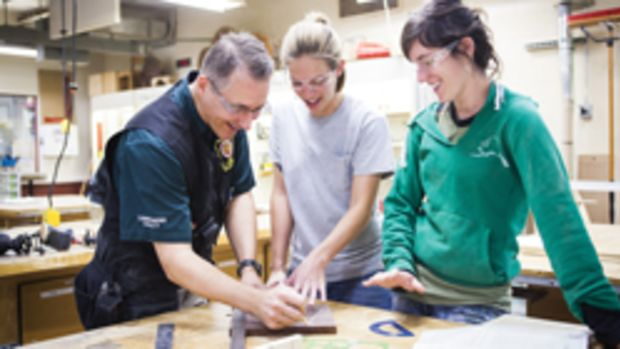 Patrick Molzahn works with students in his cabinetry and millwork program at Madison Area Technology College.