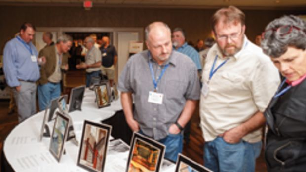 Attendees visit the tabletop exhibits at the SMA's annual conference in Tuscaloosa, Ala.