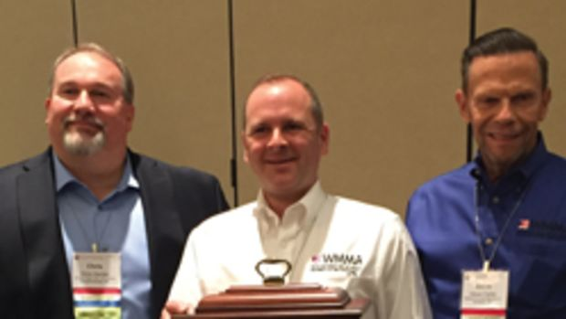 Jamison Scott receives the 2017 Ralph P. Baldwin award from WMMA president Chris Hacker (left) and vice president Steve Carter.