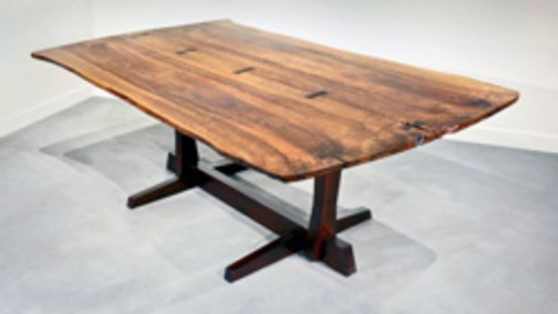 Nakashima dining table made of Persian walnut and matched with rosewood butterflies (1971).