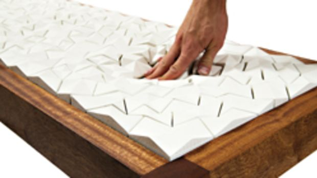 """Annie Evelyn's """"Floe,"""" in collaboration with Ian Henderson, made with sapele, foam and cement. Cast cement tiles were """"upholstered"""" to the sapele frame using a traditional button tufting technique."""
