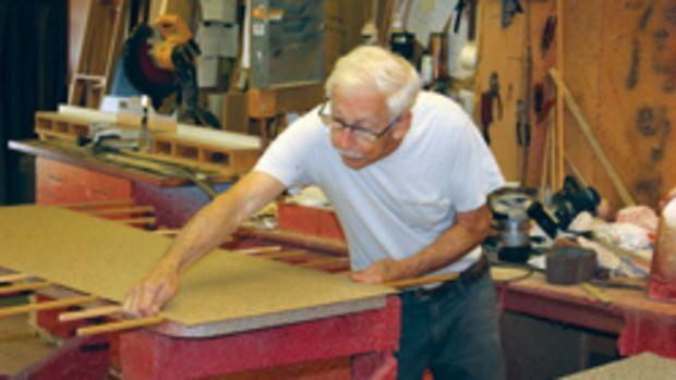 Alonzo Taylor glues a laminate countertop at Custom Woodwork Inc.