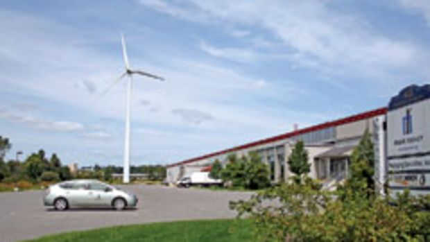 The wind turbine at Mark Richey Woodworking supplies about 80 percent of the shop's electricity.