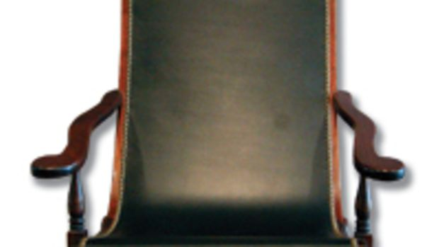 Arceneaux's mahogany-and-leather Bautac chair is based on a period chair from Patout Cottage in New Orleans.