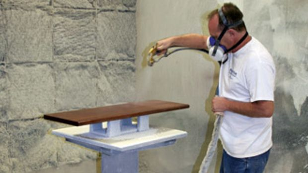 Lead finisher Jeff Neeley works in one of the 10' spray booths at The Burkhart Co., in Louisville, Ky.