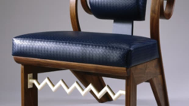 Walnut and leather chair with matte silver-plated copper.