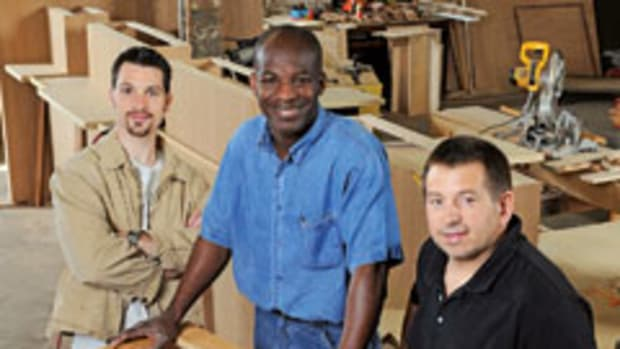 For Thomas Johnson, center, the dream of opening a woodworking school has been realized.