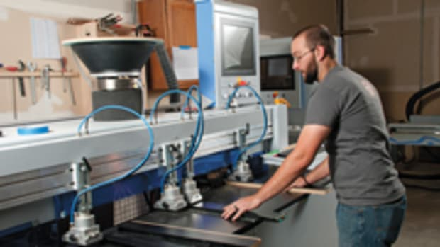 Chris Recker operates the shop's Weeke ABD 050 automatic boring and doweller.