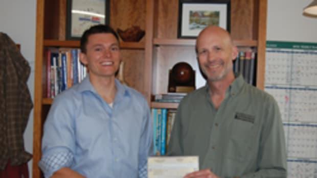 NESAW director Greg Larson (right) with student scholarship winner Jake Cazja.