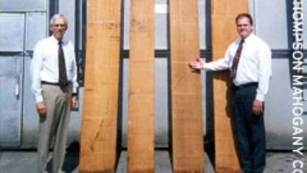 Don Thompson, left, and Ron Nienaber of Thompson Mahogany in Philadelphia display some large boards of African mahogany (Khaya spp.).