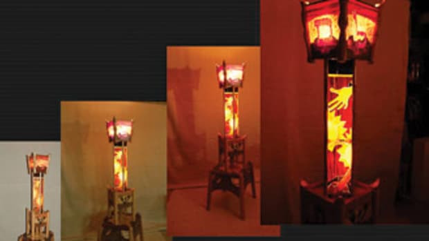"Tesser's lamp measures 21"" wide, 21"" deep and 73"" tall. Veneers include holly, peanut tamo ash, pear wood, red tinneo, walnut, walnut burl and wenge."