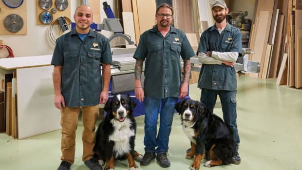 steve-anderson-with-employees-and-mascot-dogs