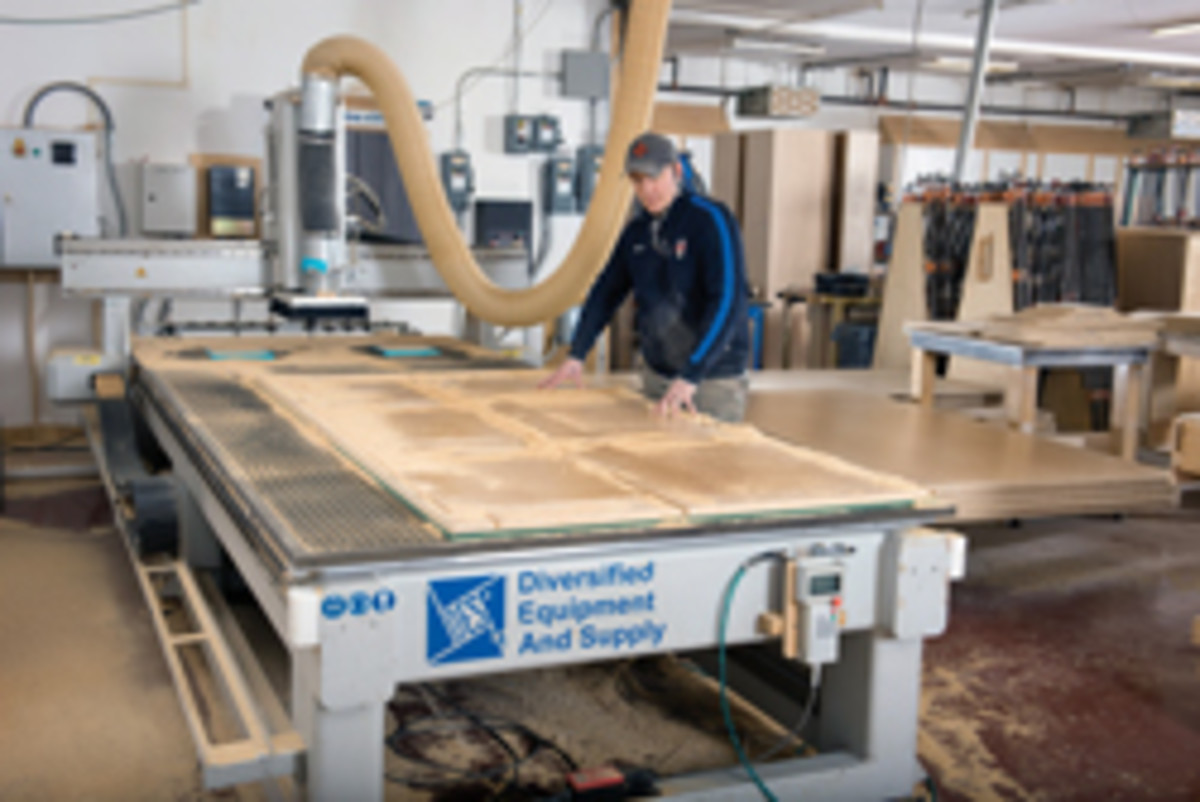 Woods operates the shop's Flexicam CNC and a recent kitchen project.