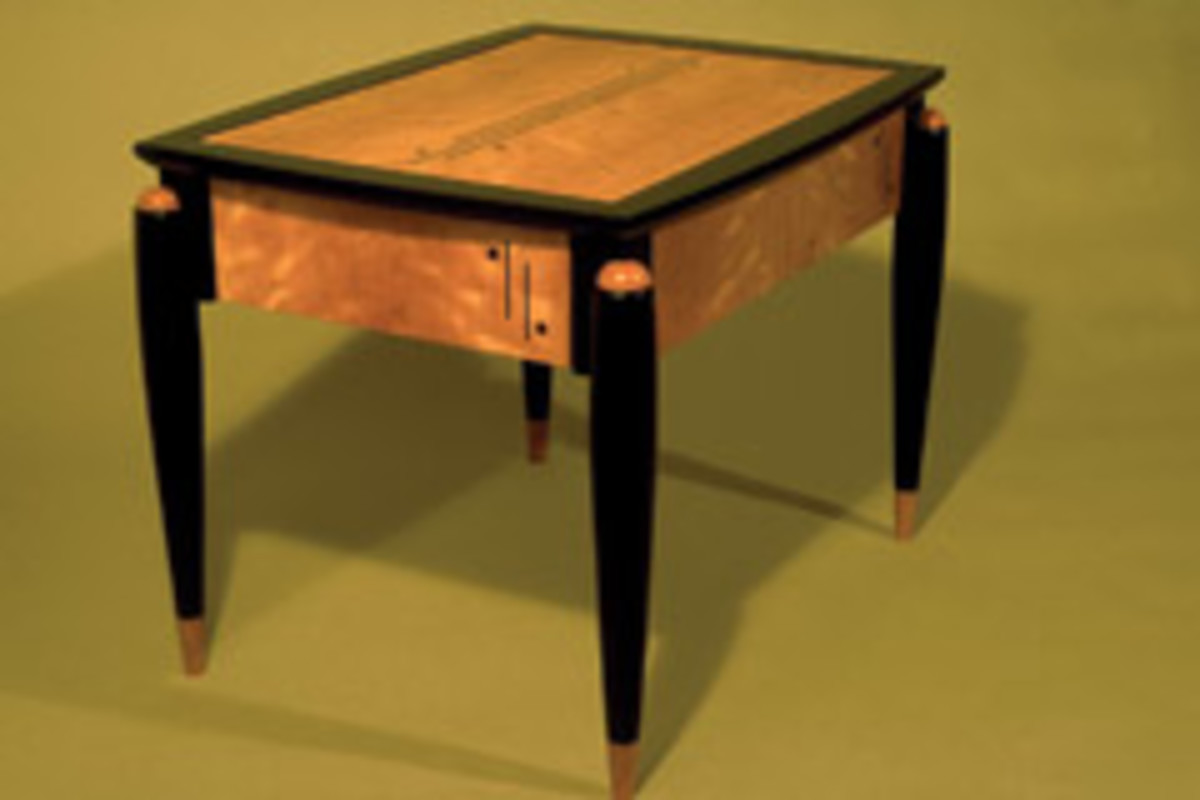 Bubinga and Macassar ebony were used for an Art Deco liquor cabinet that has tambour doors that open to the sides.