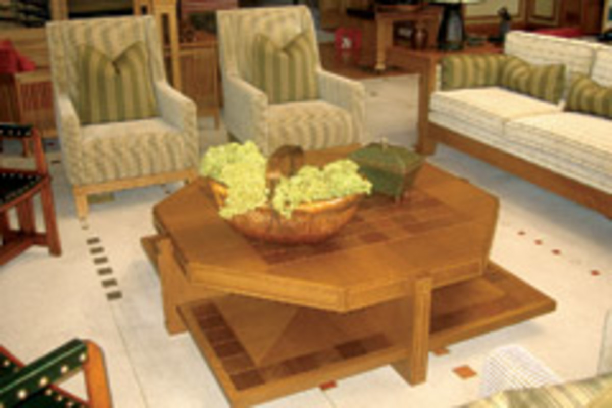 Lesch's Prairie-style coffee table has an octagonal top with square shelf. It was built with whit oak and white oak veneer. The inlaid tiles are made of stamped copper wrapped over a ceramic tile.