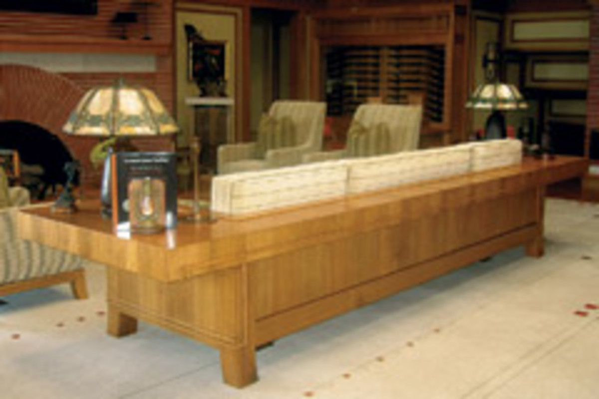 "This Prairie-style sofa measures 168"" x 42"" x 32"". The cantilevered arms offer 24"" of end table space."