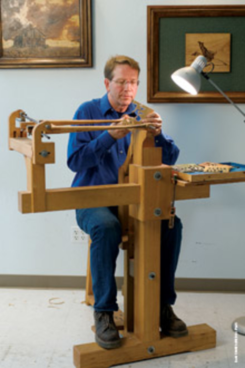 Edwards at his marquetry cutting easel, which uses a horizontal blade.