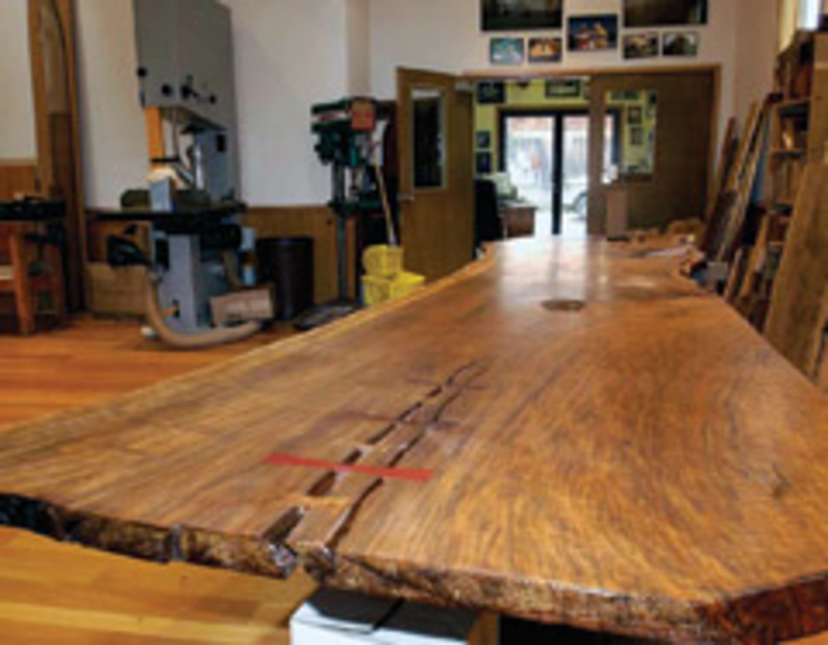 Sam Talarico of Talarico Hardwoods says large walnut slabs, such as this one in his studio, are in demand for consumers wanting large, decorative table tops.
