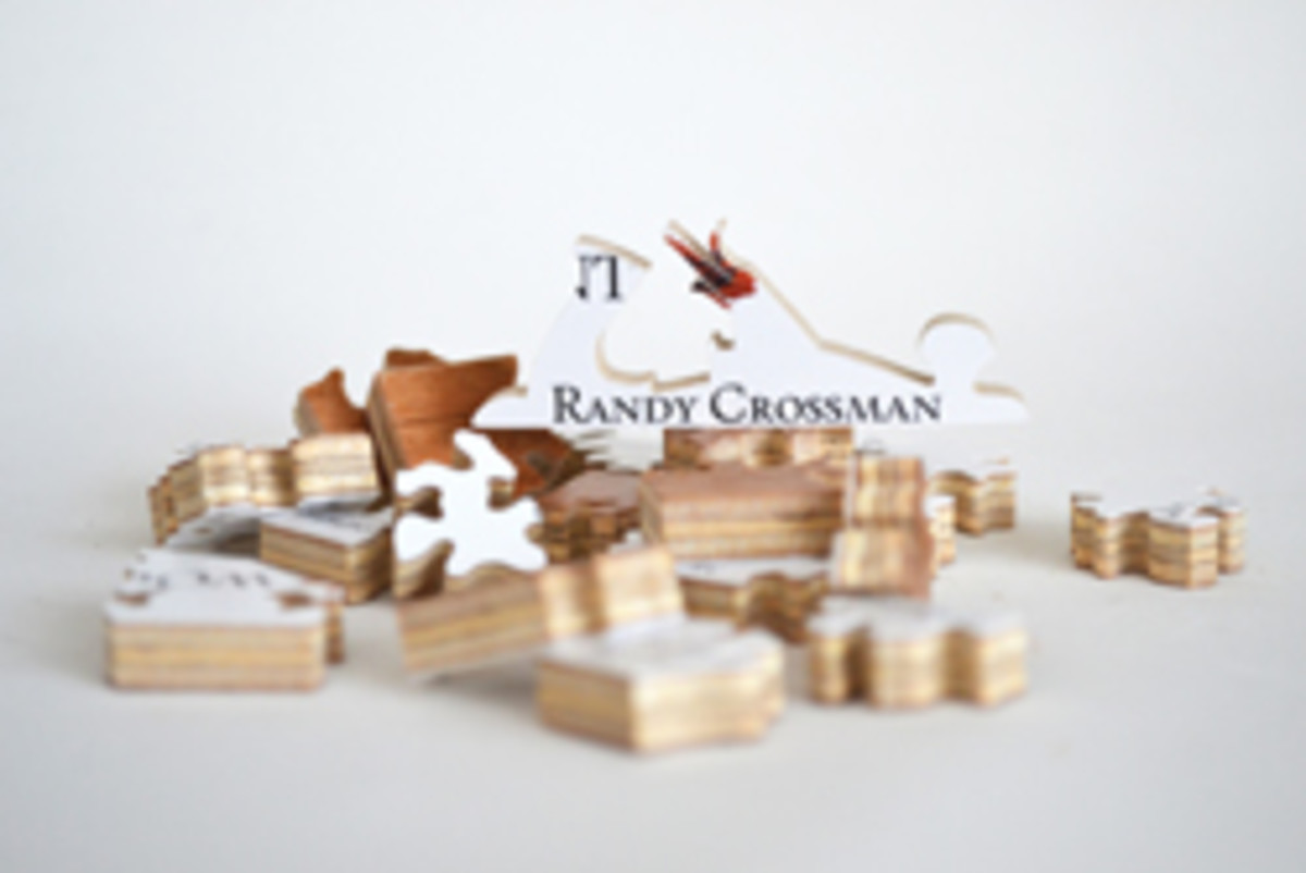 Randy Crossman, a master puzzle-cutter, infuses the corporate gift industry through hand-cut wooden business card and corporate logo puzzles.