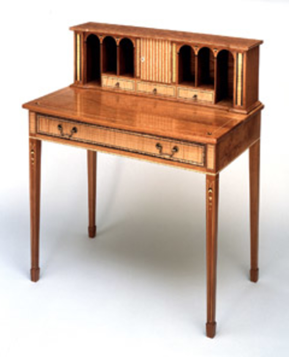 This lady's writing desk is made of cherry and curly maple with an ebony inlay.
