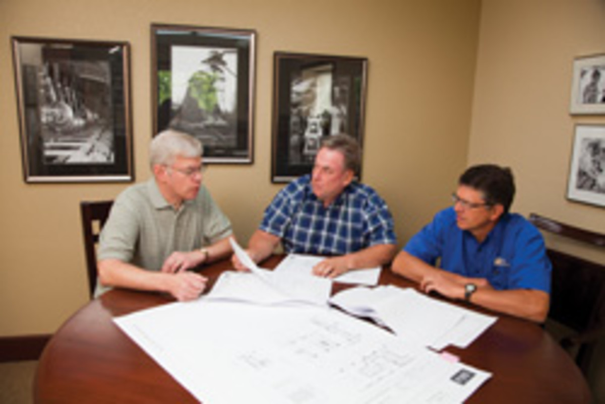 From left, project manager Larry Lotter meets with co-owners Gordon Lundquist and Don Gunstone.