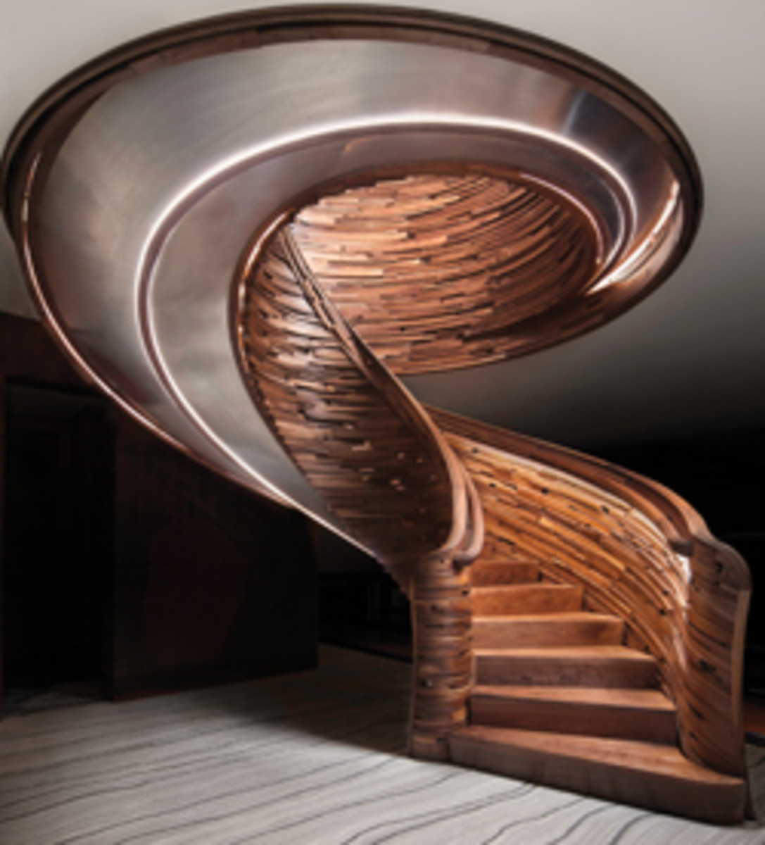 The best modern curved stairway, crafted by NK Woodworking & Design.