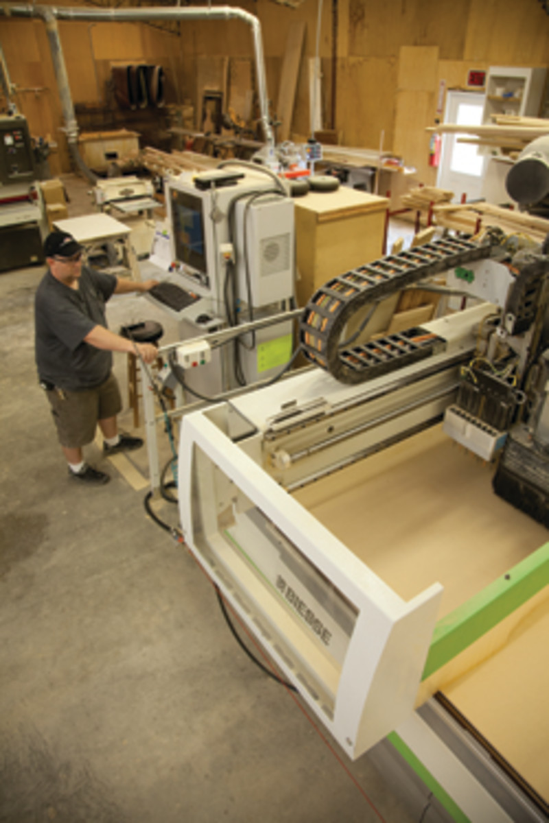 Wesley Foxworth operates the Biesse CNC machine at Maple River Woodworks in Coward, S.C.