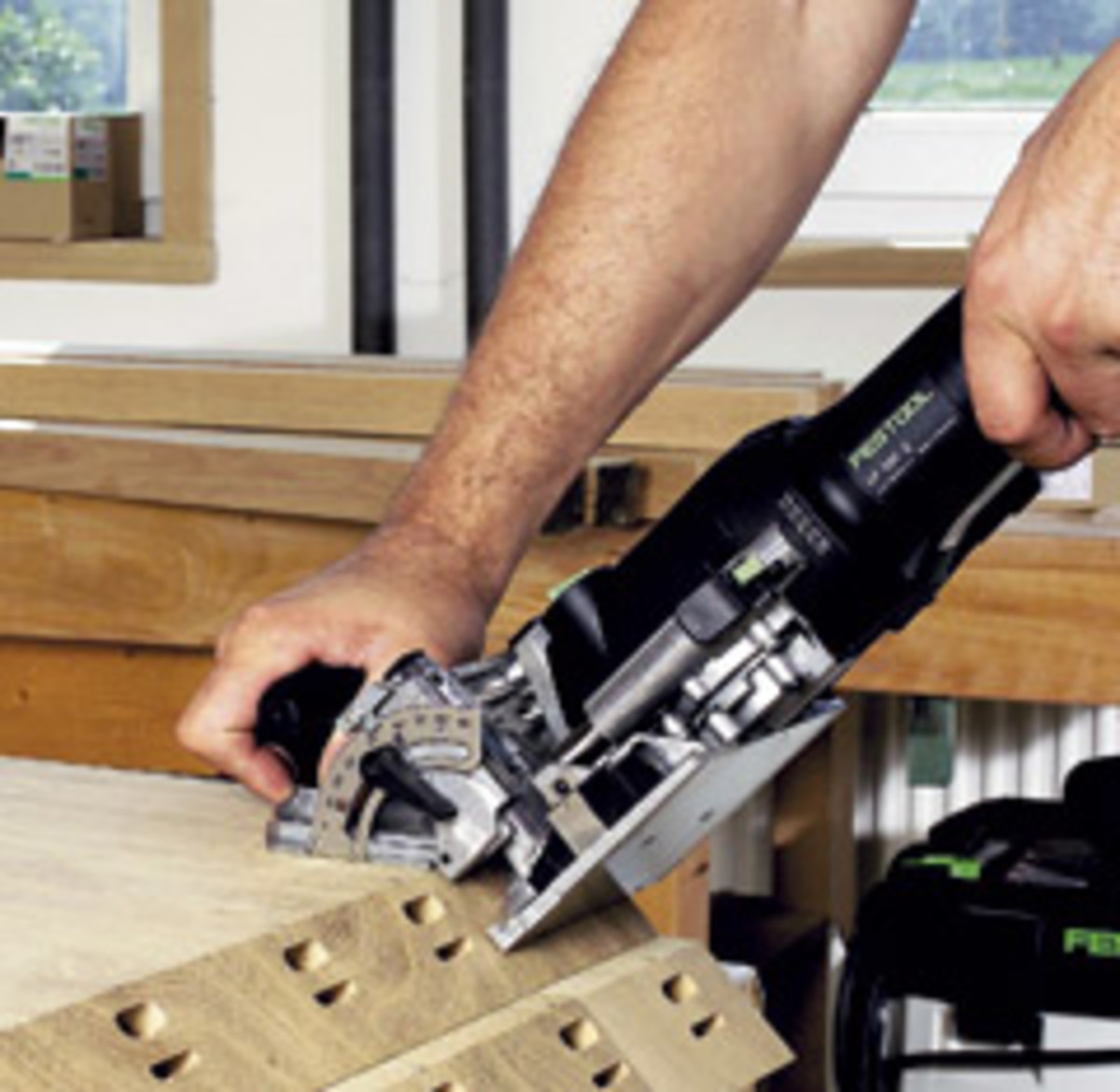 The Domino, from Festool, cuts two mortises and a separate, floating tenon is used to complete the joint.