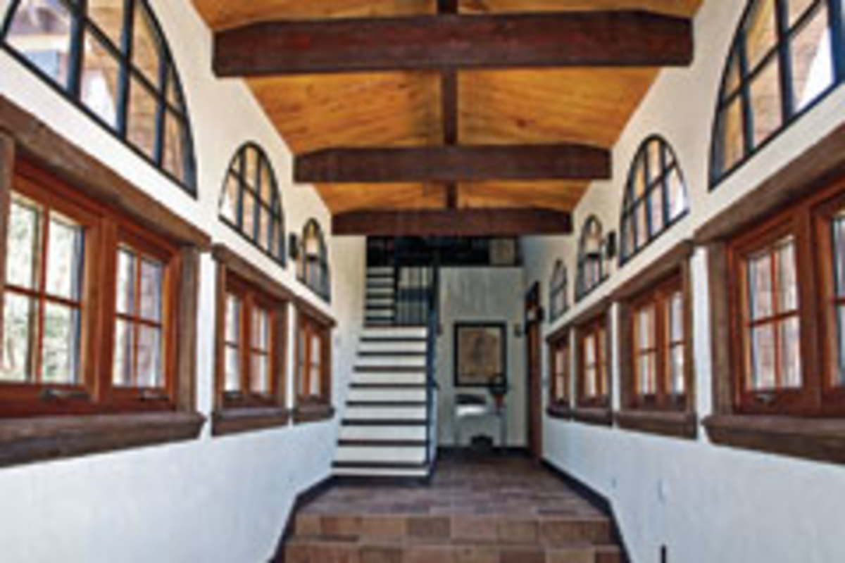 Tule Peak recycles hand-hewn Douglas-fir beams, cedar ceiling panels and black oak window trim to create a Tuscan look in this custom home.