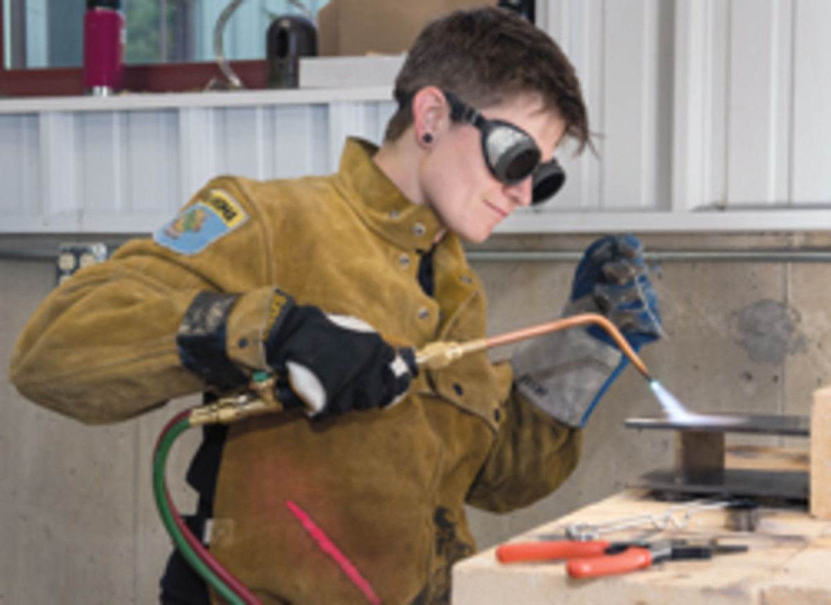 Jesse Morrisey, also of VAC Inc., brazing an architectural bronze bracket.