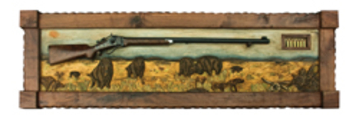 """Artisans of the Valley offer custom carving such as this piece by Eric Saperstein titled """"Shiloh Prairie"""" with a reproduction 1874 Shiloh Sharps rifle."""