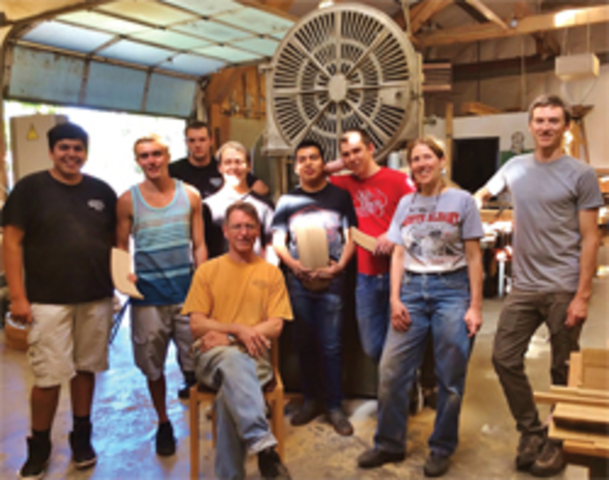 Gary Rogowski (seated) with visiting students at the Northwest Woodworking Studio.