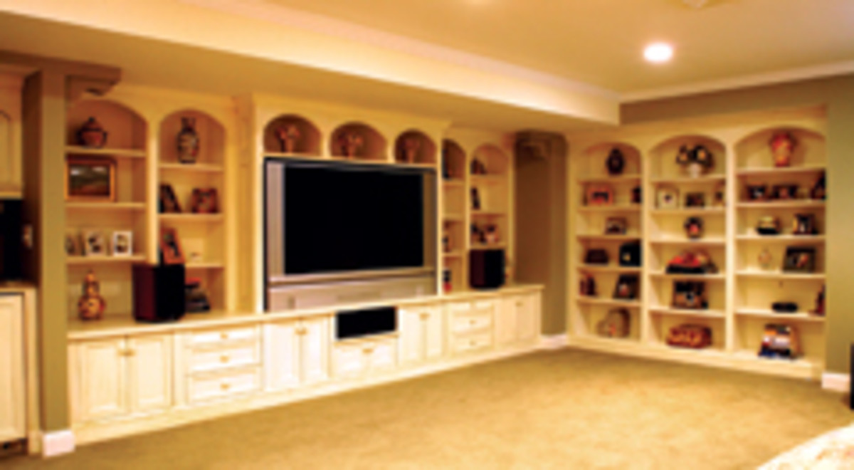 This large built-in case piece was built for a client's family room. The entertainment center is on the left and the potential for a library is on the right.